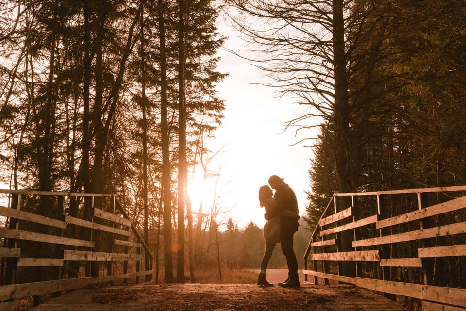Mont-Tremblant engagement photo of couple silhouetted by sunset