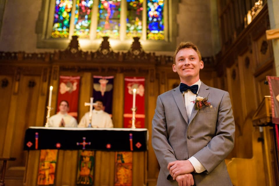 Groom waiting for bride at the aisle