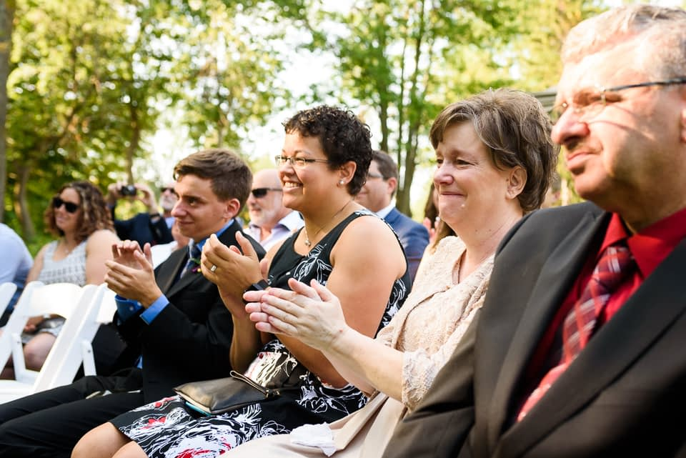 Family clapping during wedding ceremony