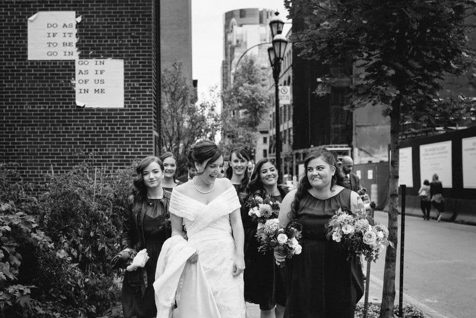 Bridesmaids walking together in downtown Montreal