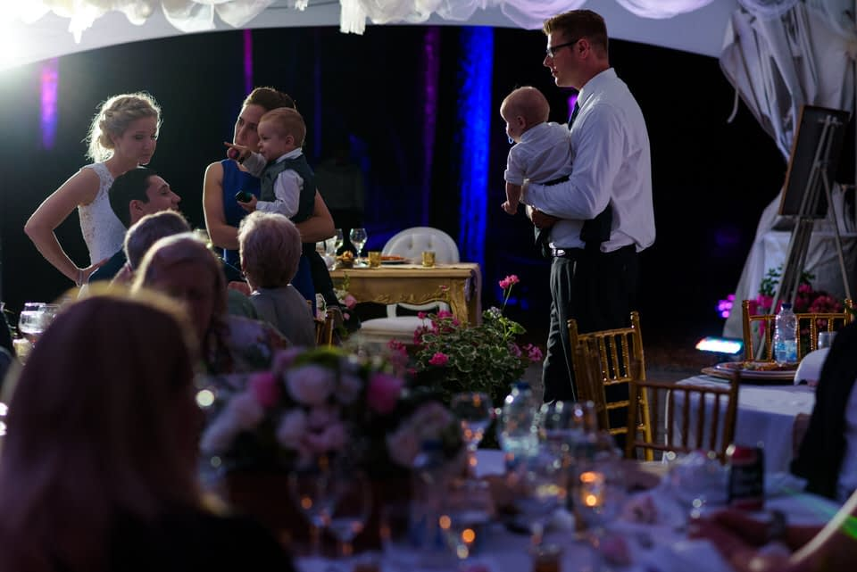 Wedding guests chatting at night time reception