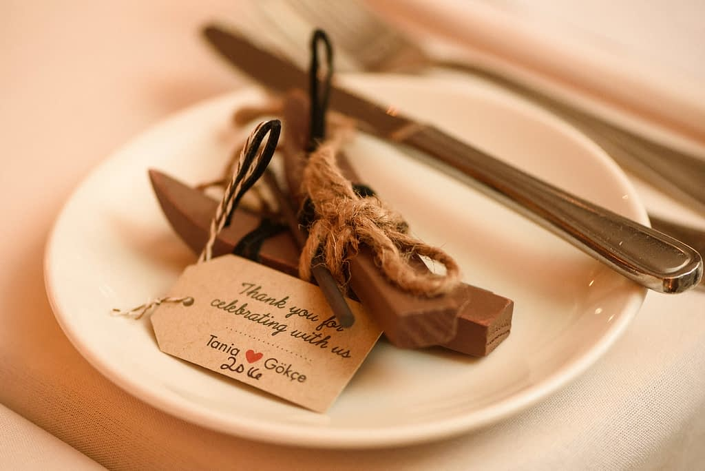 A wooden carved wedding favour