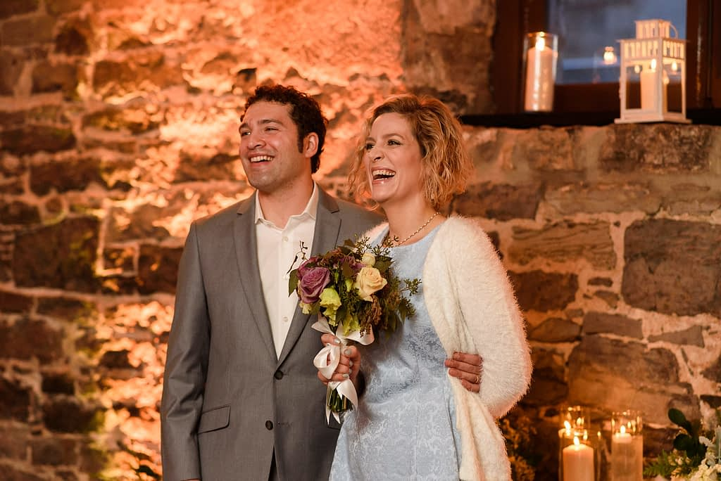 Wedding officiants laughing