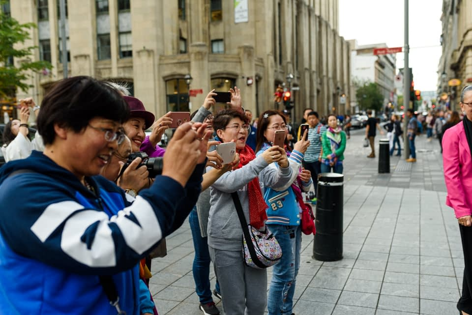 Tourists taking photos of wedding in Old Montreal