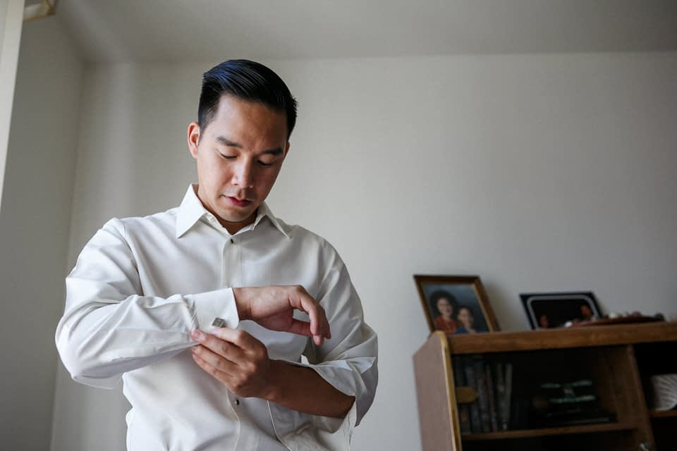 Groom getting ready in his parent's home