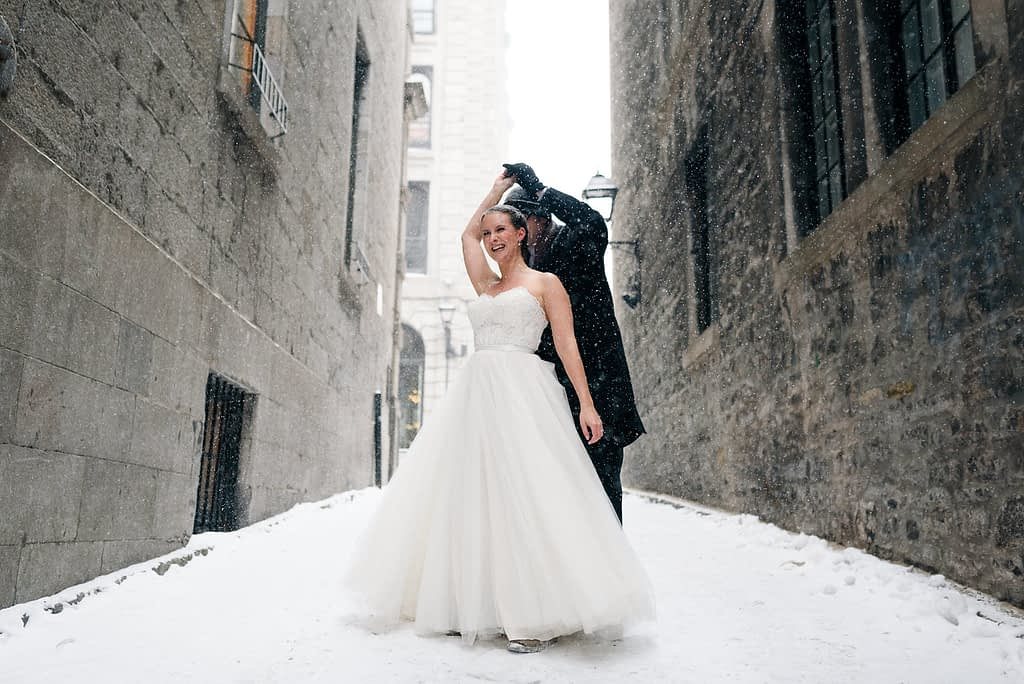 Wedding couple dancing in the snow