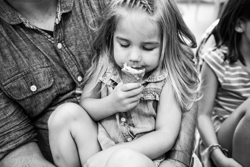 Child eating ice cream in documentary family photo