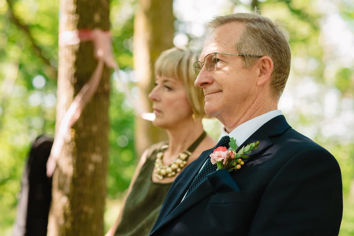 Father of the bride watching the ceremony