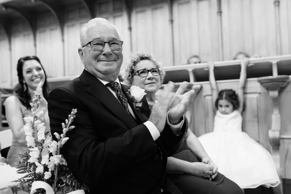 Parents clapping at wedding ceremony