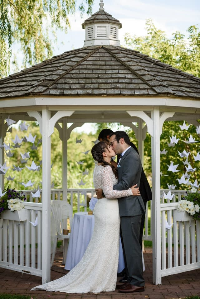 First kiss as husband and wife at Auberge des Gallant wedding