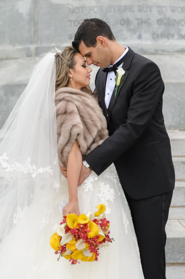 Wedding portrait at the Sir Georges Etienne Cartier statue at Mount Royal