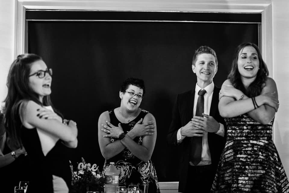 Wedding guests singing a song