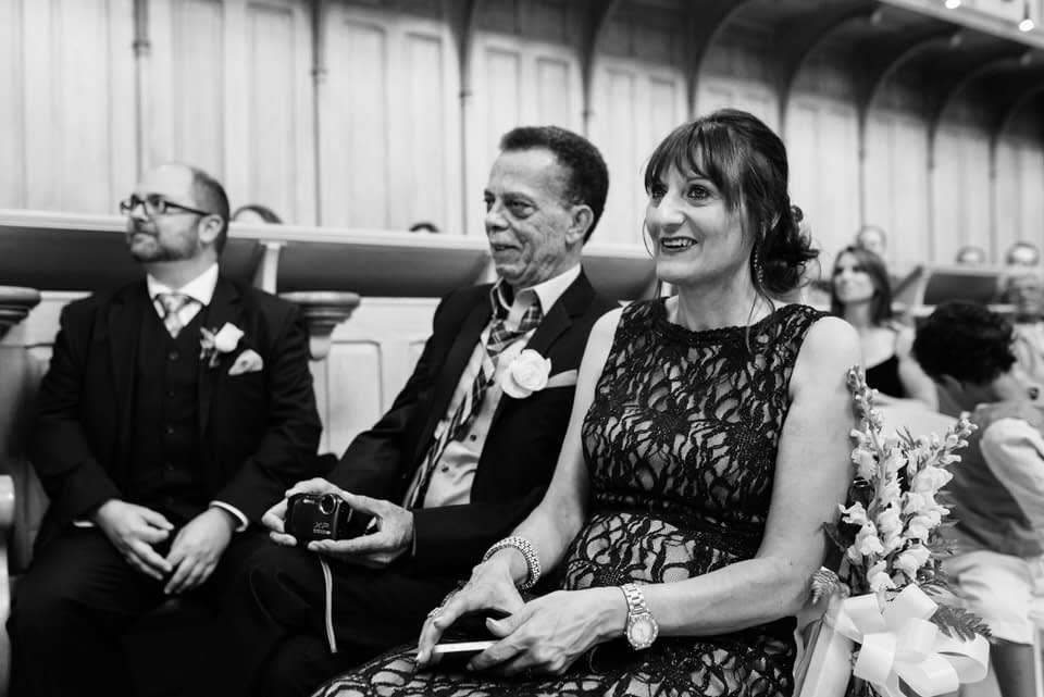 Parents smiling at wedding ceremony