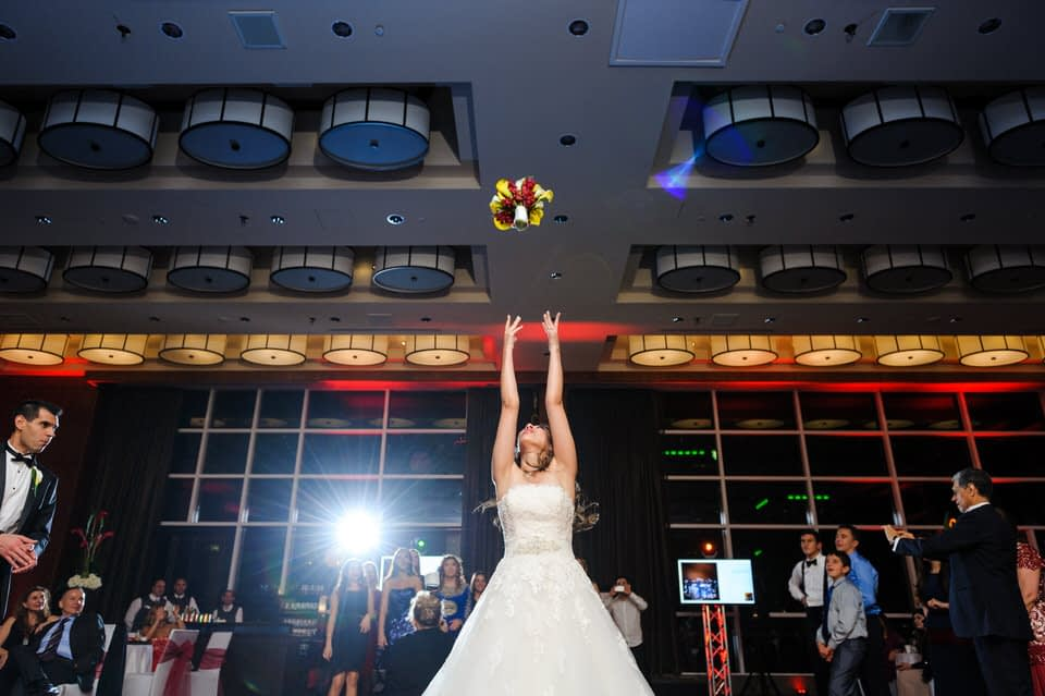 Bride tossing the bouquet at Le Westin Montreal wedding reception