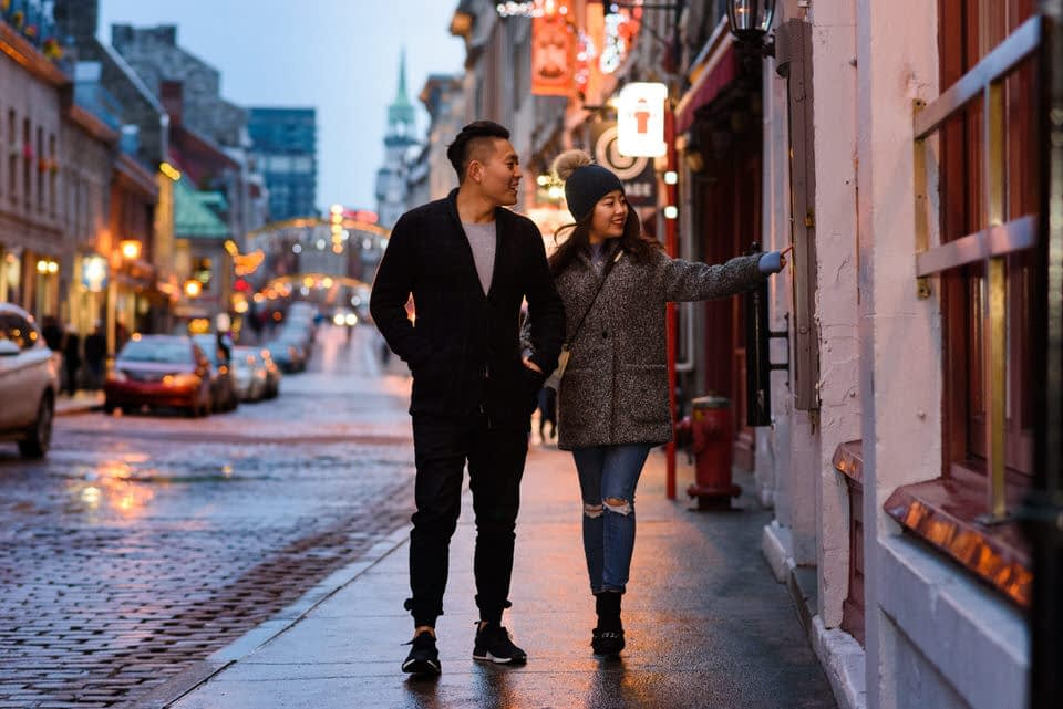 Couple walking in Old Montreal and checking out restaurants