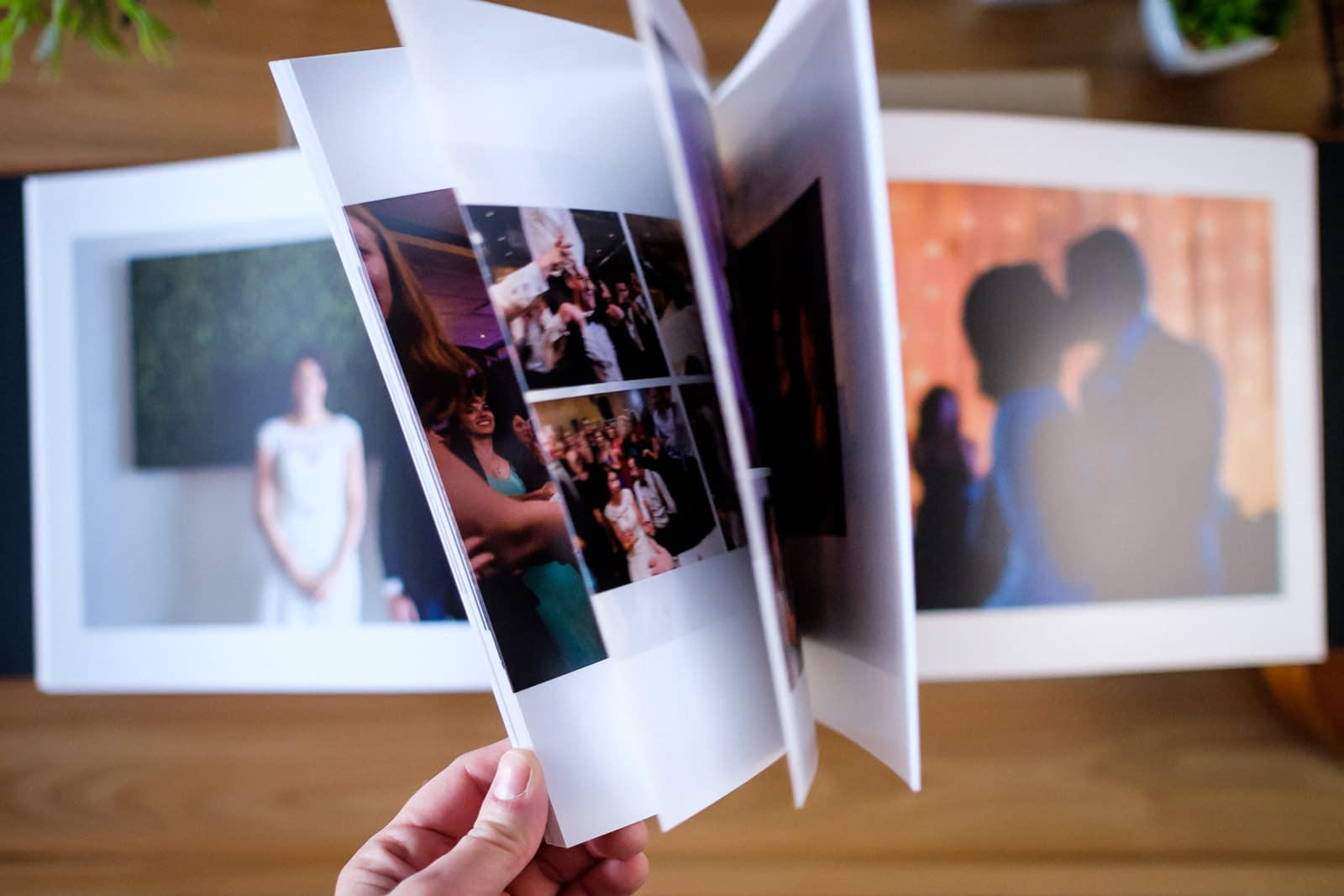 Wedding album with hand flipping through pages