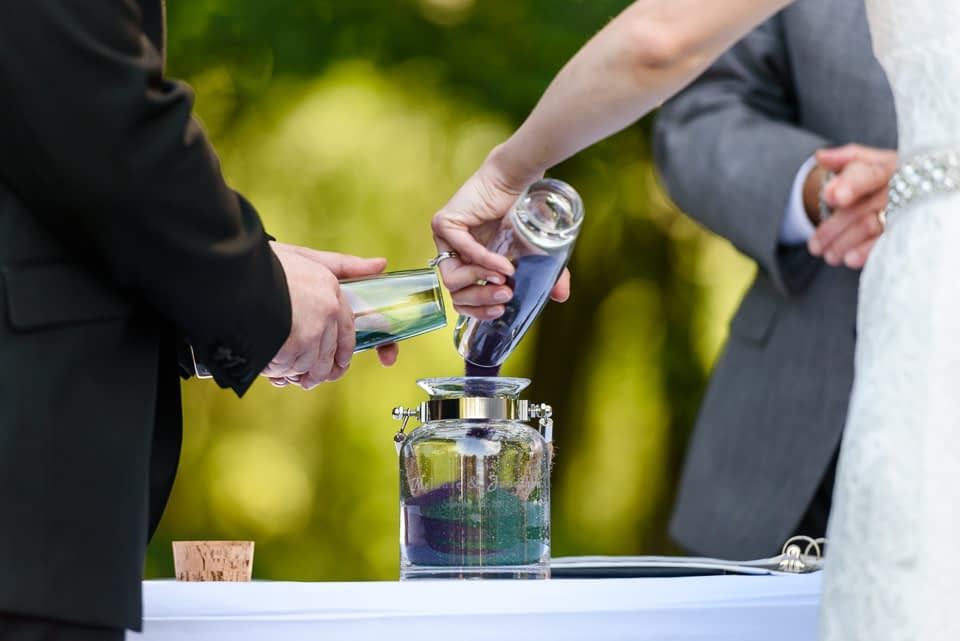 Sand ceremony at outdoor wedding