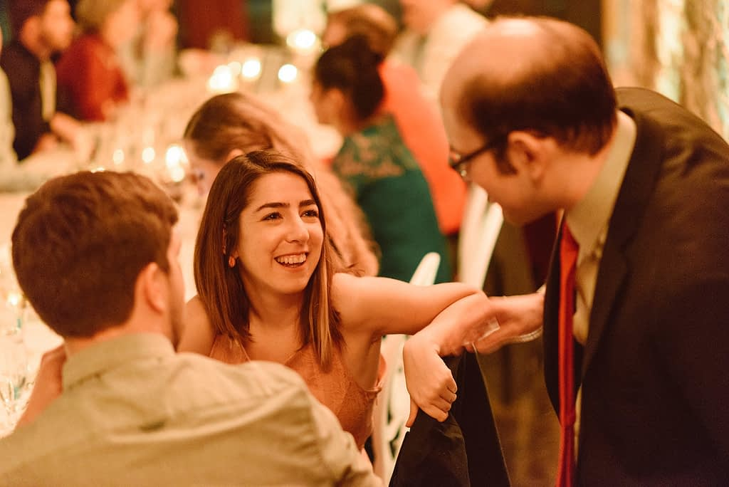 Wedding guest talking with groom