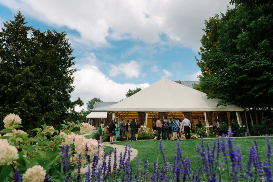 Outdoor wedding under tent at Manoir Rouville-Campbell