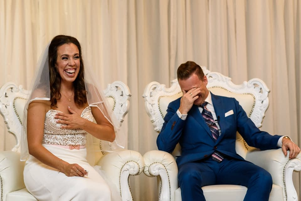 Bride and groom cracking up