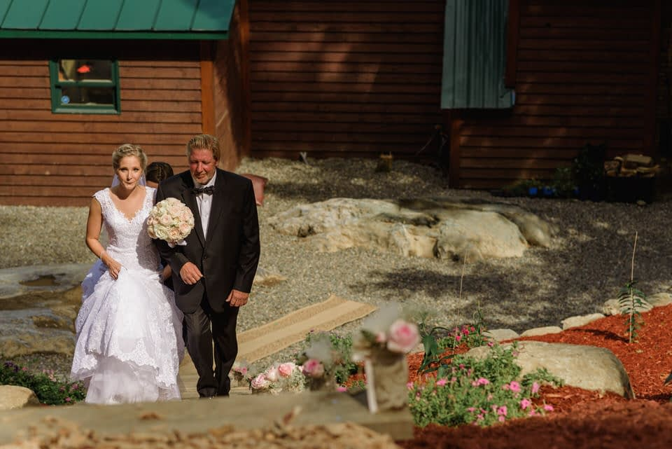 Bride and father walking up stairs
