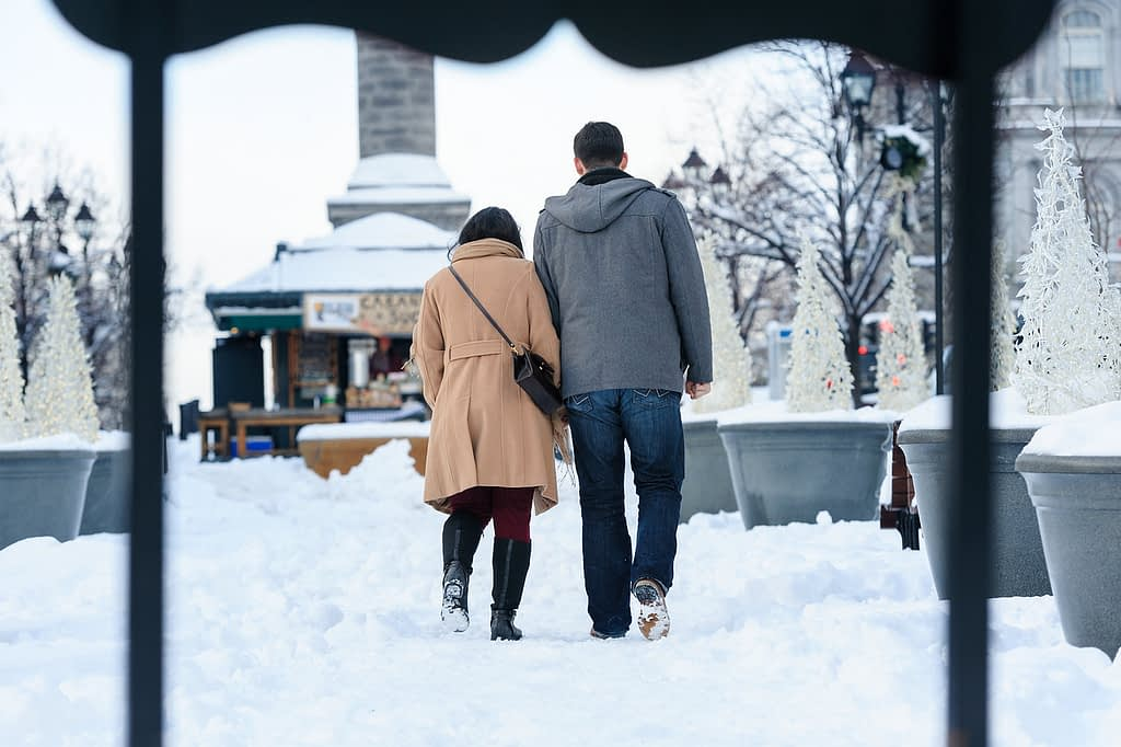 Couple walking in the snow in Old Montreal