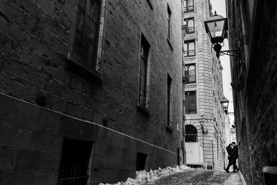 Romantic engagement photo in Old Montreal alleyway