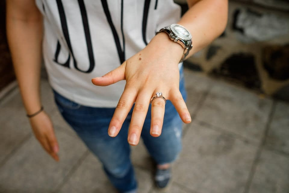 Holding out hand with engagement ring