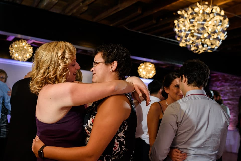 Bride's sister and her wife dancing