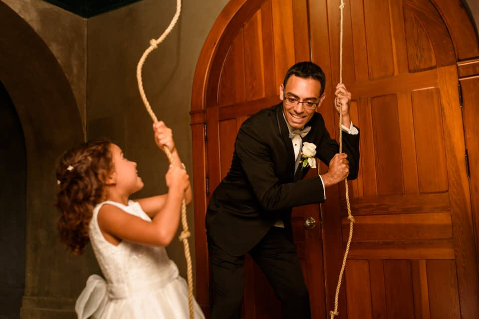 Groom ringing the chapel bell at Abbaye Oka with his daughter