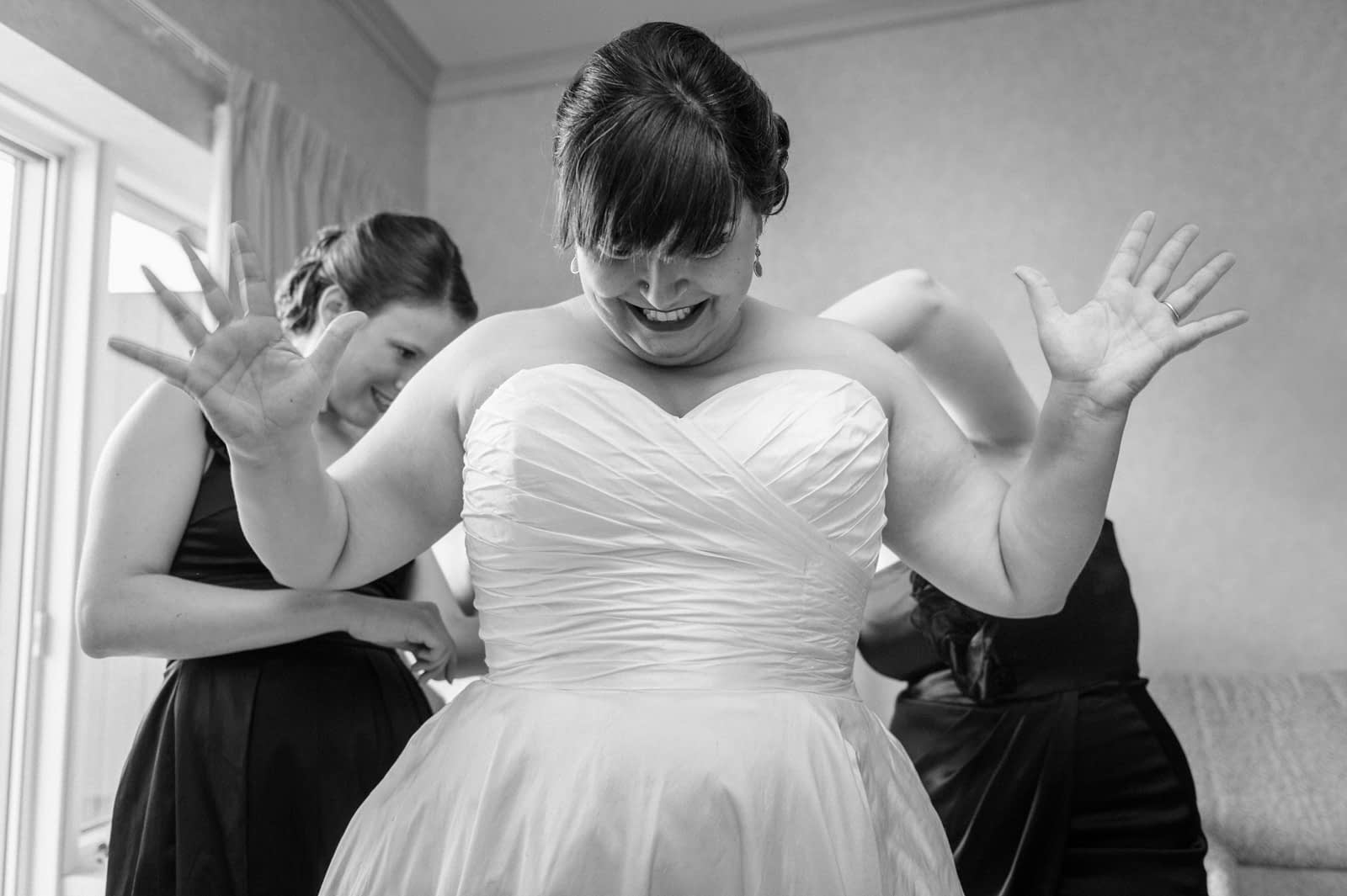 Excited bride with wide open hands