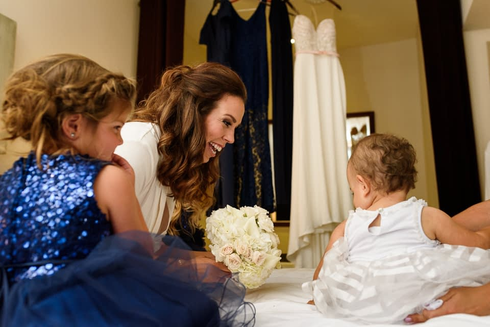 bride laughing at baby in Hotel Nelligan
