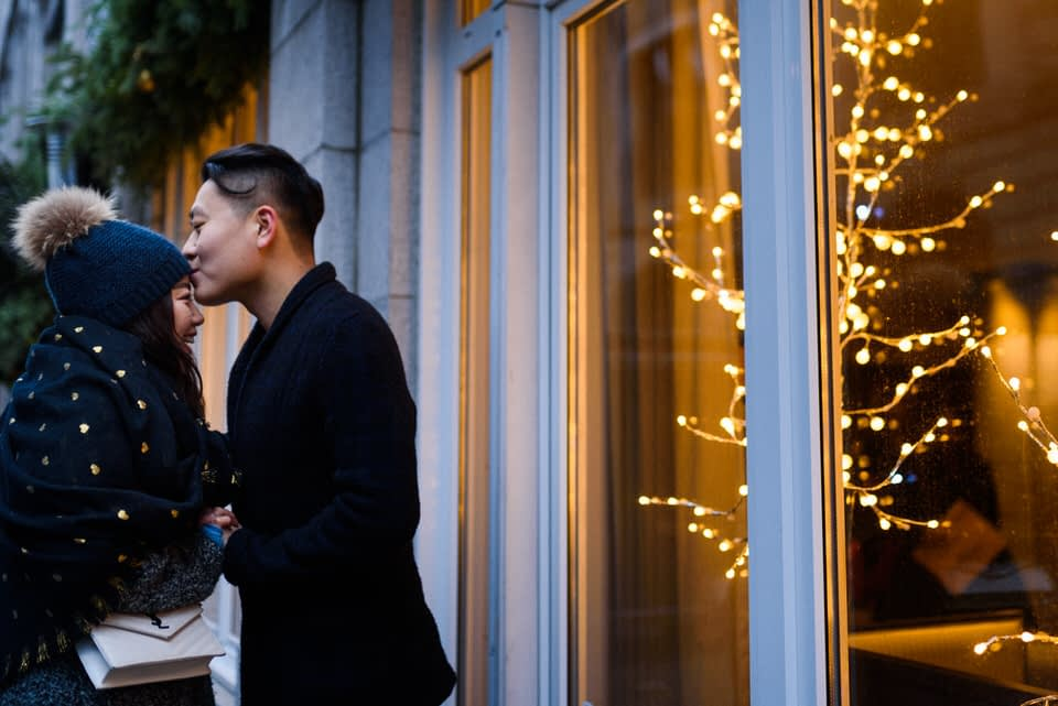 Couple's photos in front of St-Sulpice Hotel