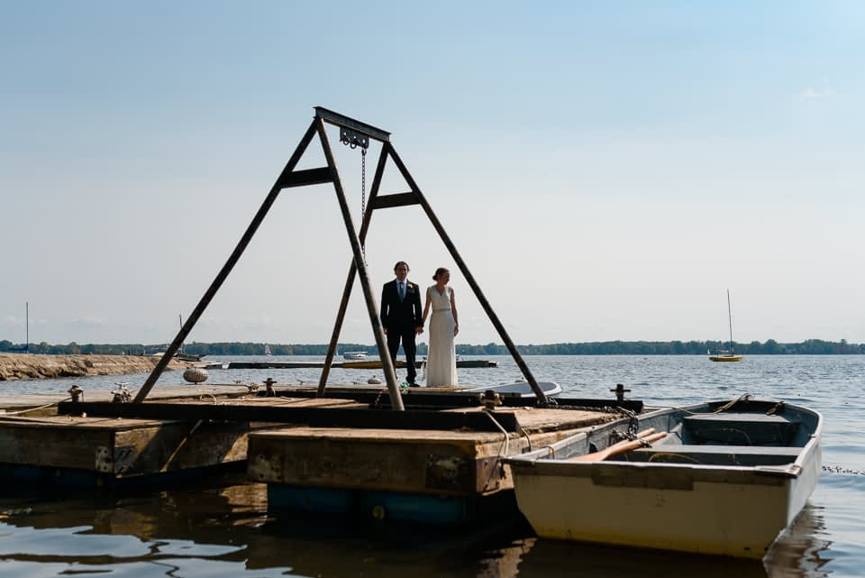 Wedding on a dock framed by structure