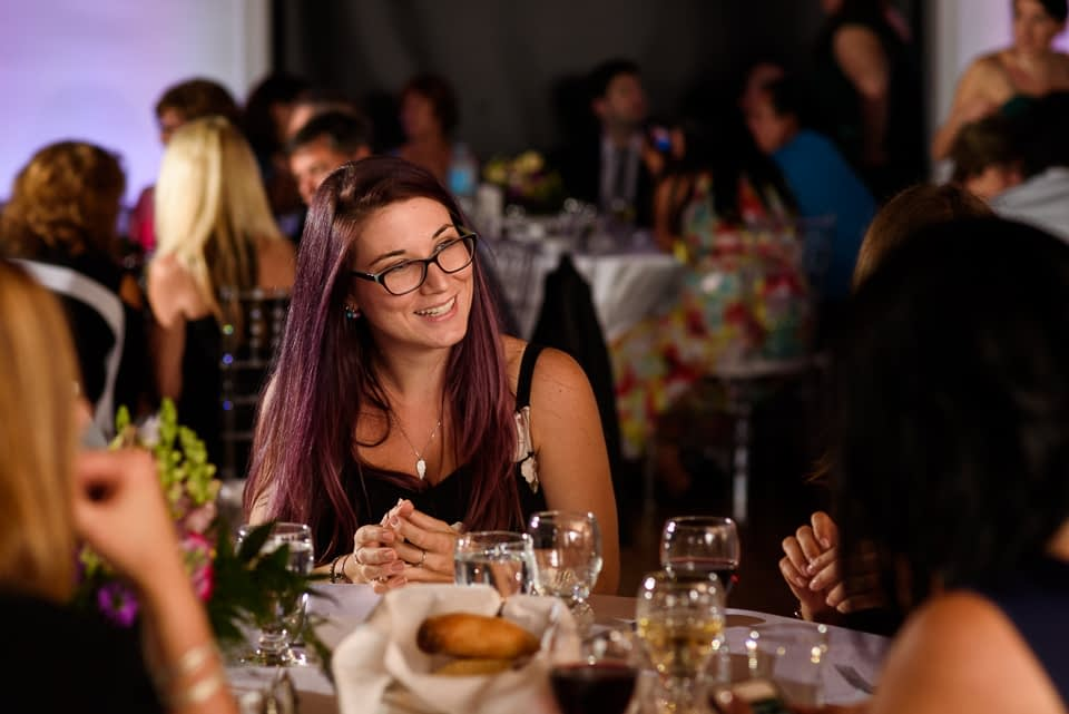 Wedding guest smiling at dinner