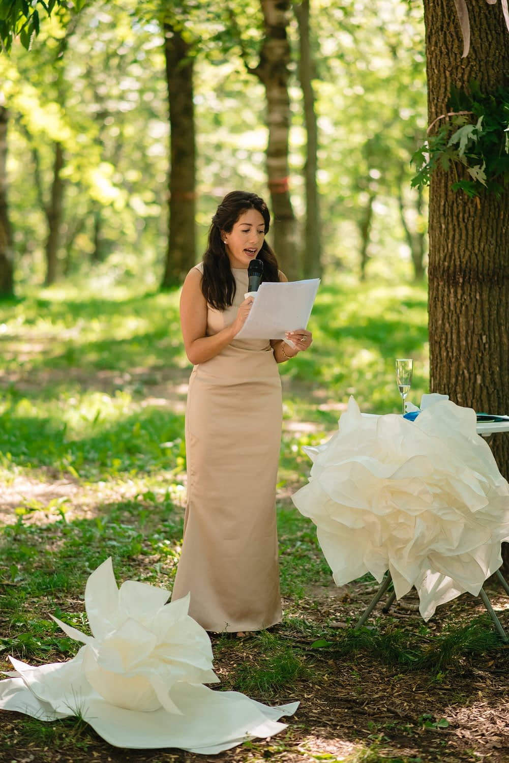Groom's sister reading during wedding ceremony