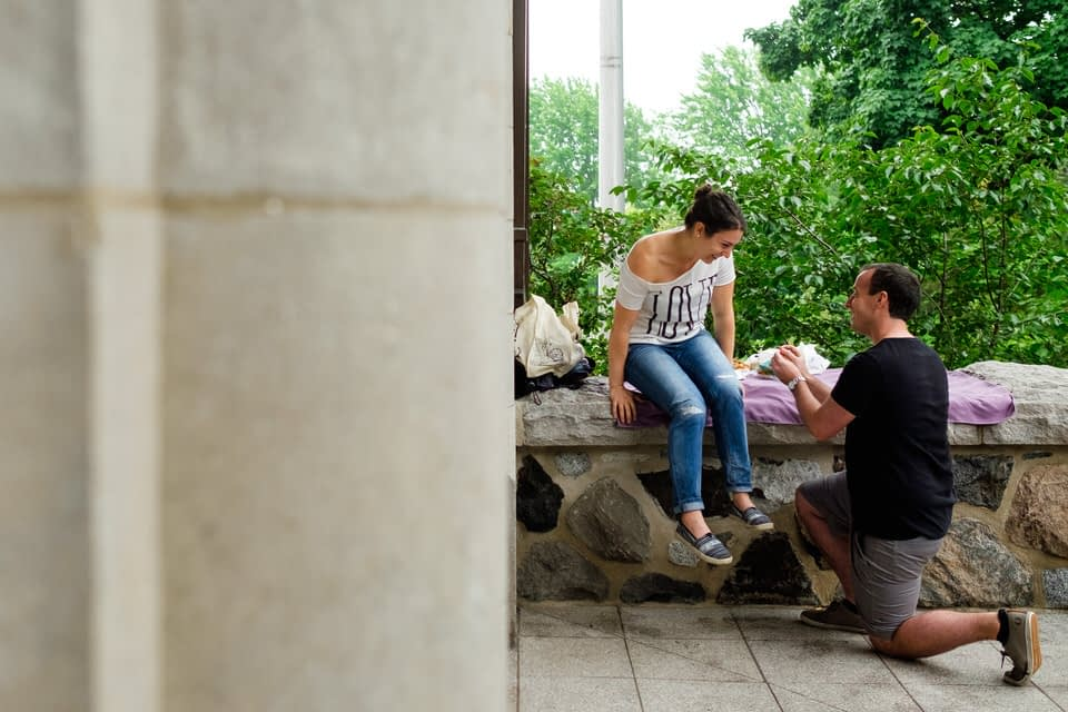 Surprise proposal on balcony of Mount-Royal Chalet