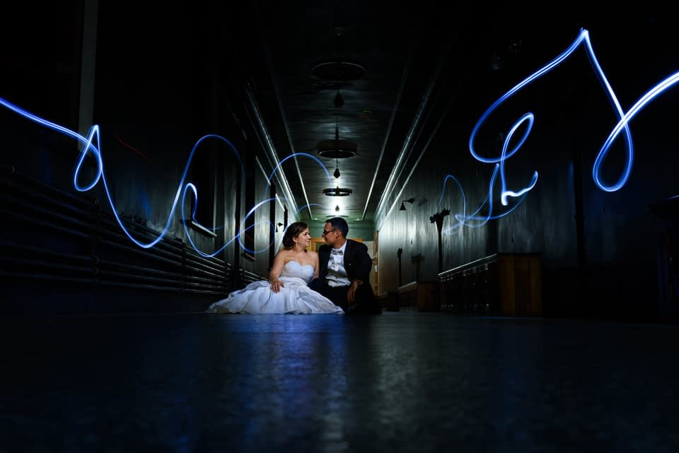 Creative night portrait of wedding couple with lights and long exposure