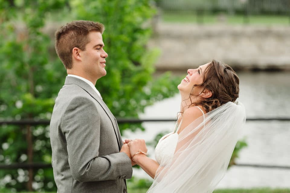 Wedding couple holding hands with excited faces