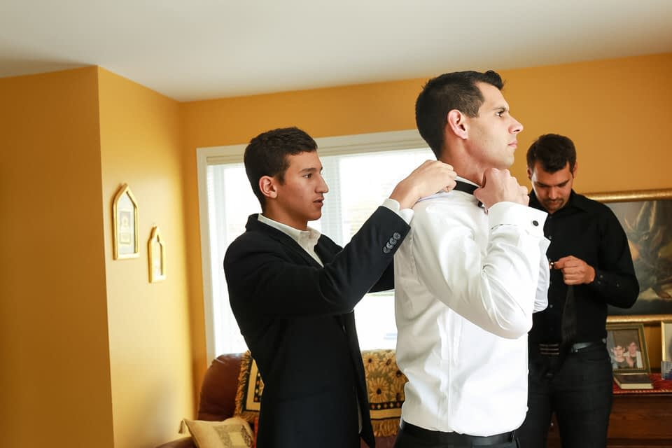 Groom getting ready in his parents' home