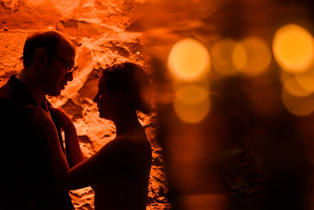 Silhouette of bride and groom in candlelit room