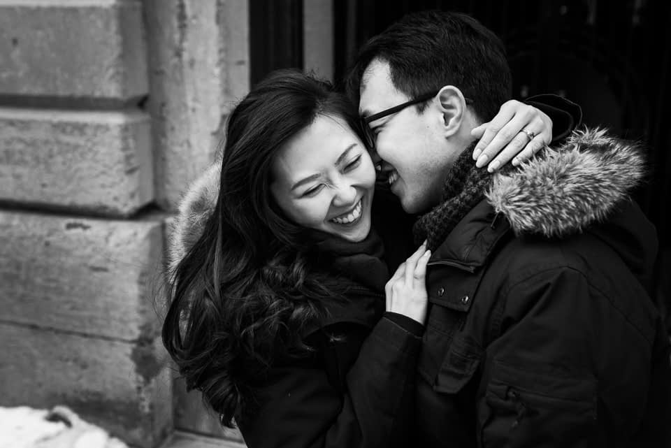 Laughing photo of engaged couple in winter shoot