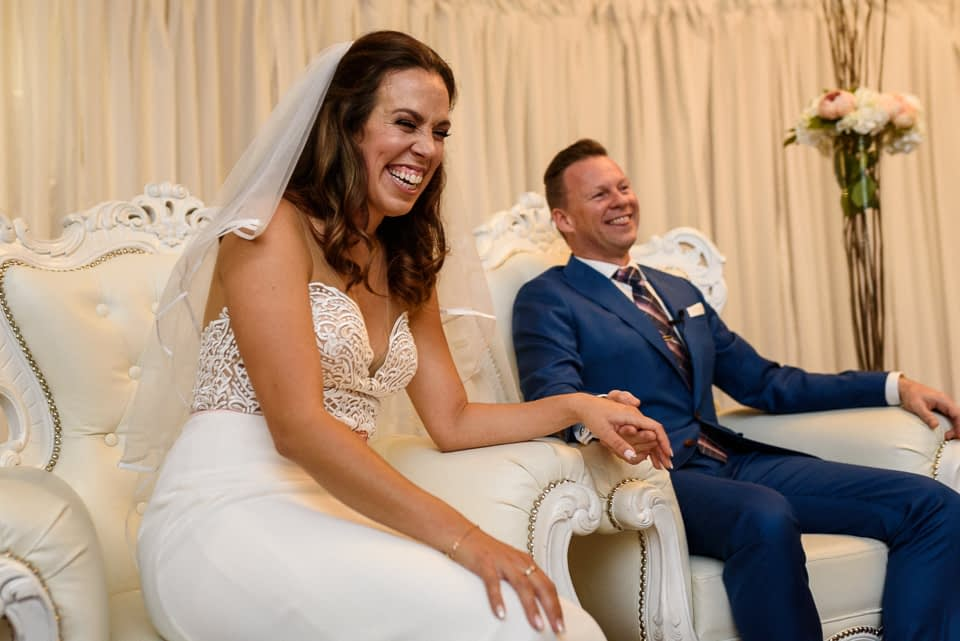 Bride and groom laughing during Hotel Nelligan wedding ceremony