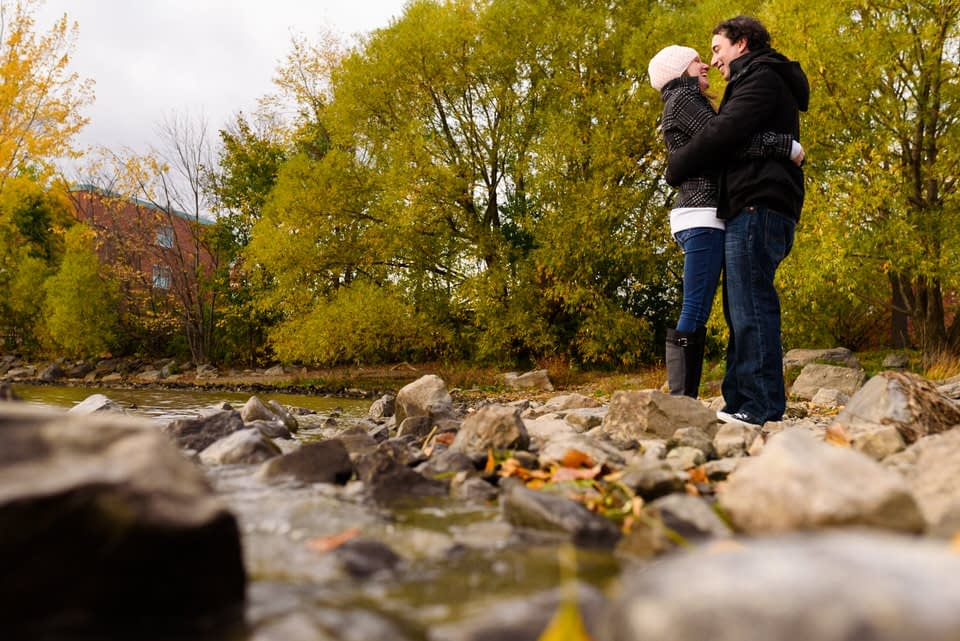 Artistic shoot of couple holding each other near river