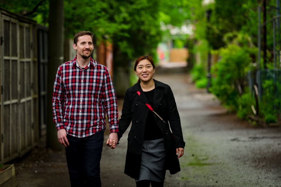 Couple vacation photoshoot in Montreal green alleyway
