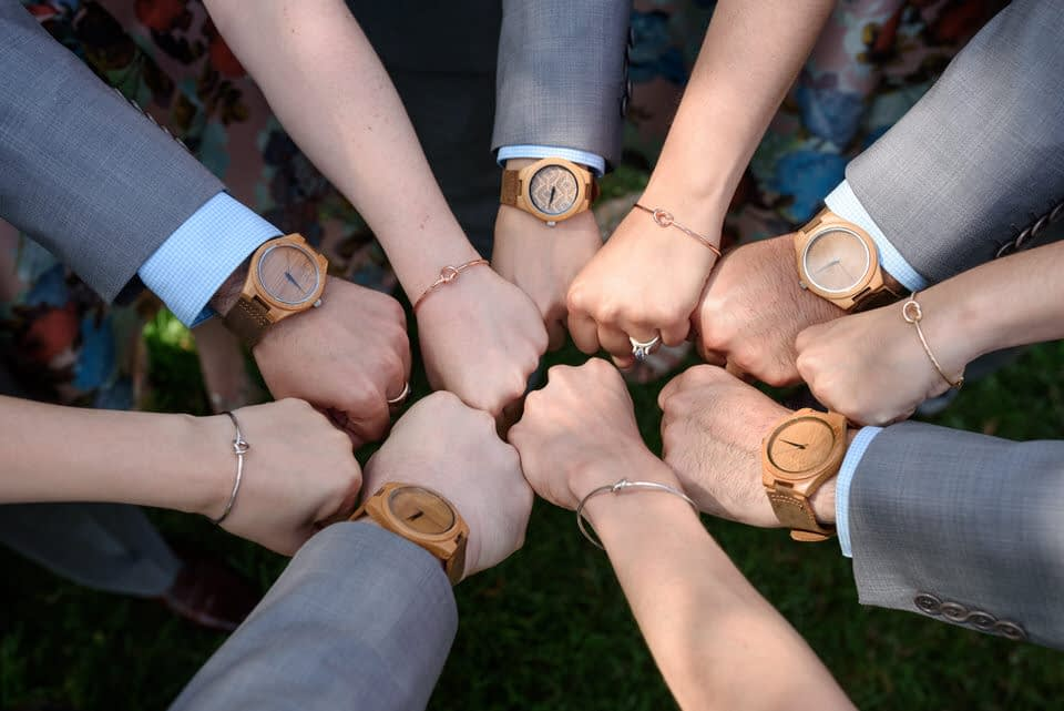Matching wooden watches and knot metal bracelets for wedding party