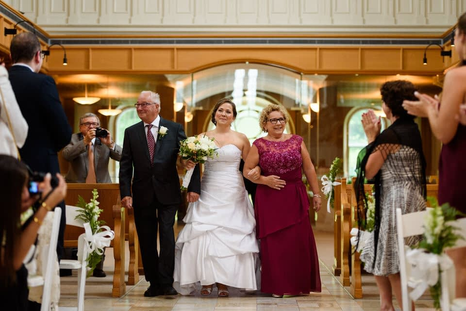 Bride and her parents entering the Abbaye Oka