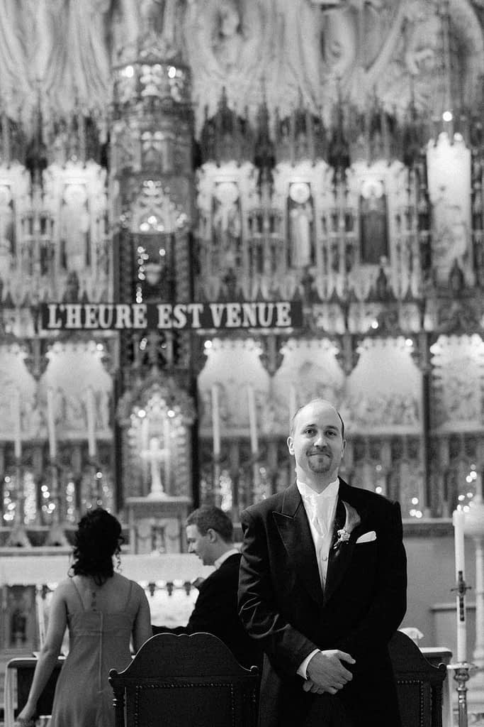 Groom standing at front of church