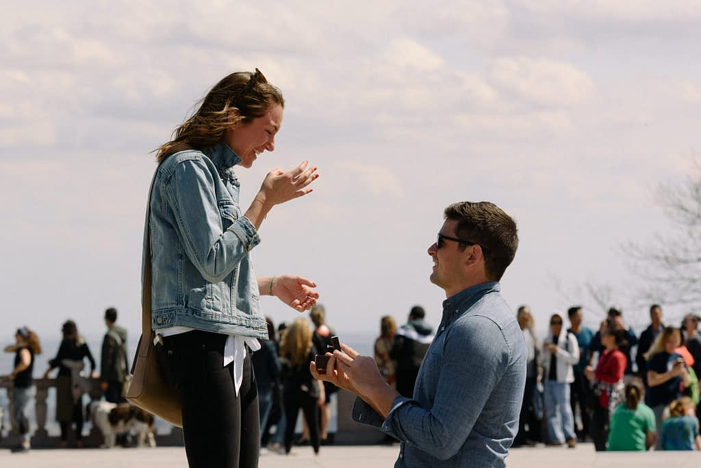 Proposal at Mount Royal lookout with crowd behind