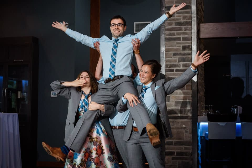 Friend lifting groomsman at the end of a special choreography